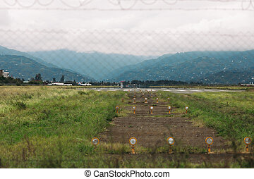 runway for an airplane in the mountains