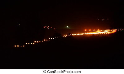 Runway lights. Night Landing of a large aircraft at the airport