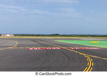 runway of airport with cloudy sky