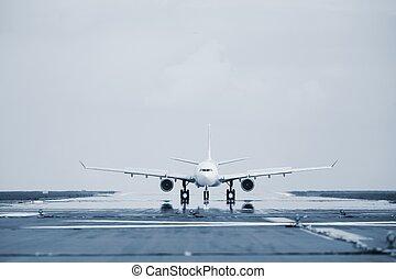 Runway - Airplane is landing on the airport