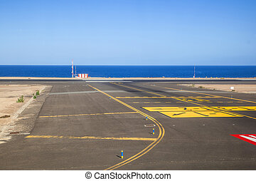 runway with ocean in the background
