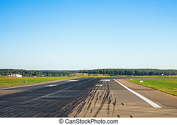 Runway with traces of rubber wheels of the aircraft free for takeoffs and landings at the airport