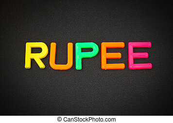 Rupee in colorful toy letters on black background
