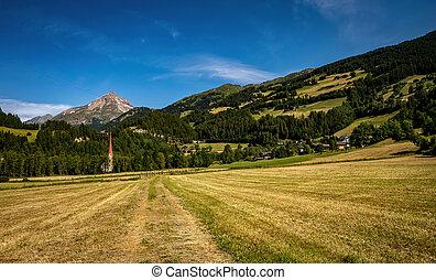 Rural Alpine landscape with Church of St. Martin in Pockhorn near Heiligenblut in Hohe Tauern National Park, Austria