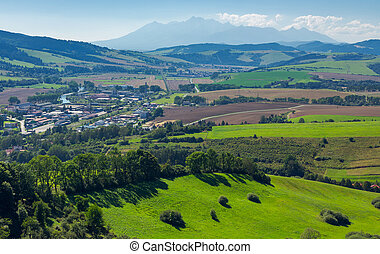 rural area around the town. grassy hill and agricultural...