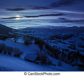 rural area in mountains at night - few houses of village on...
