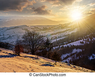 rural area in mountains at sunset - few houses of village on...