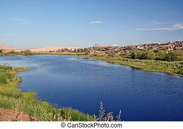 Rural area in the town of Mirny, Irelyakh bridge over the river.