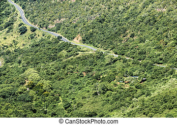 Rural Asphalt Road Winding Through Green Valley