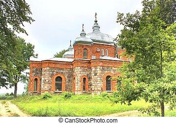 Rural brick small church in wood, 1