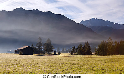 buildings and mountains in fog