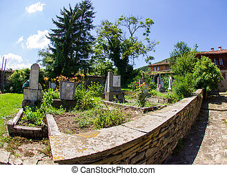Rural churchyard in Bulgaria