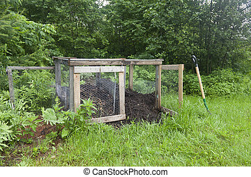 Rural Compost Bin - A compost bin with fresh compost on the...