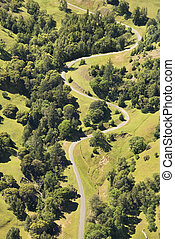 Rural curvy road. - Aerial of road curving through rural...