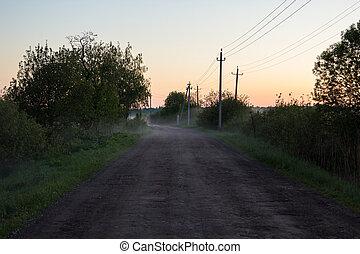 Rural dirt road at sunset in fog - Rural dirt road at sunset...