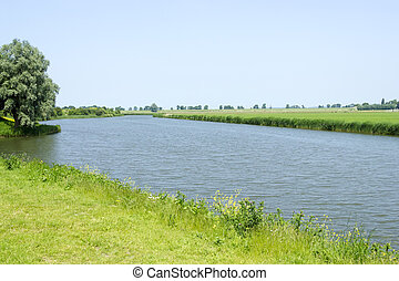 Rural dutch landscape with a river