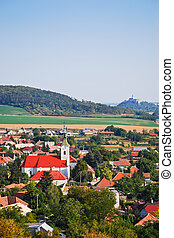 Village and rural environment with castle dominated in the background