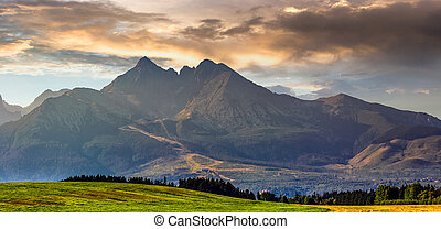 rural field in Tatra mountains - Panorama of Tatra mountains...