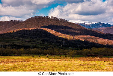 rural fields at the foot of the mountain - rural fields at...