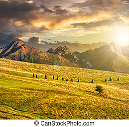 Rural fields near the high mountains at sunset - Composite...