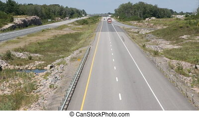 Rural highway with truck. - Truck goes by with oversized...