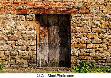 Rural house with wooden door