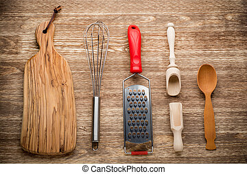 Rural kitchen utensils on vintage wood table from above - rustic background