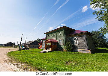 Rural landscape and wooden houses. Remote village in Karelia Republic, Russia.