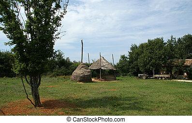 Rural landscape, farm yard with a haystack