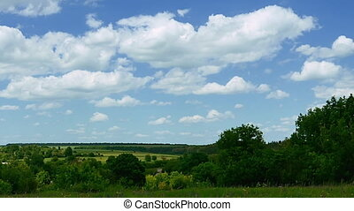 Rural landscape timelapse with blue sky and green meadow....
