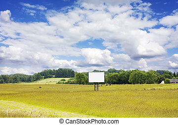 rural landscape with cows and blank billboard