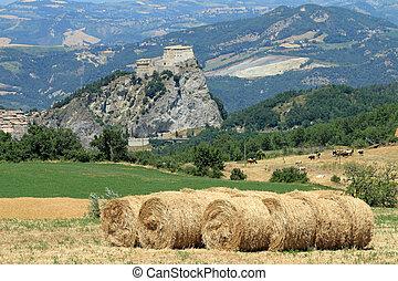 rural landscape with San Leo castle - province of Rimini,...