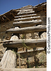 Rural landscape with stairs and old stone building