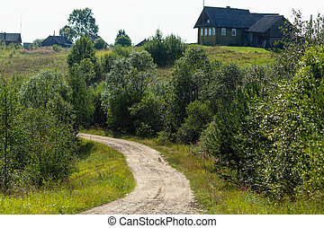 Rural landscape, wooden houses. Remote village in Karelia Republic, Russia.