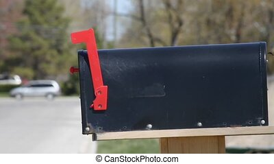 Rural Mail Box - Man gets mail out of old rural mail box