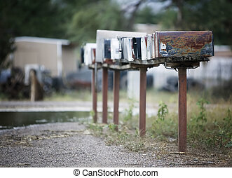 Rural Mailboxes - Rural mailboxes in a row alongside a...
