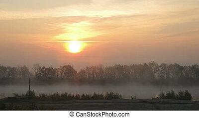 rural mist landscape with sunrise