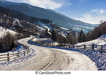 rural mountain road in snow - Empty asphalt mountain road...