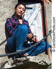 Rural portrait of latino woman at doorway