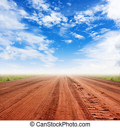 rural road and blue sky with clouds