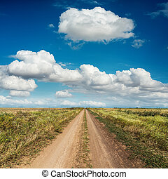 rural road and deep blue sky with clouds