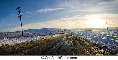 Rural road on a sunset with snow - Rural unpaved road waving...