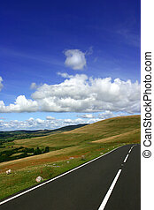 Rural Road - Rural mountain road, with fields, trees and...