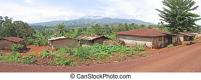 Rural road with red ground over the valley, Cameroon, Africa, Panorama