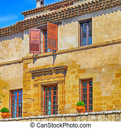rural sandstone house with shutter windows in  Saint-Paul de Vence,Provence, France