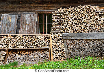 Rural scene firewood stacked in a mountain hut