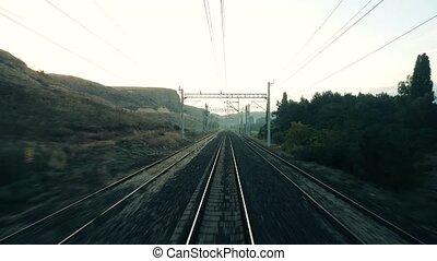 Rural scene through the passenger train window - Travelling...