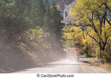 Rural School Bus on Unpaved Road