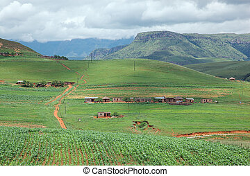Rural settlement on foothills of the Drakensberg mountains, ...