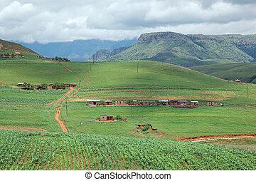 Rural settlement on foothills of the Drakensberg mountains,...